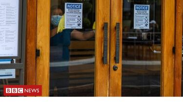 California reimposes restrictions amid virus spike