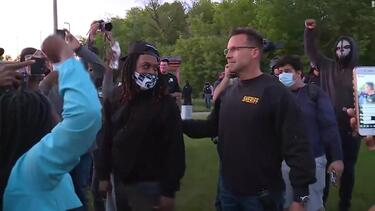 Michigan sheriff takes off riot gear and joins peaceful protesters - CNN Video