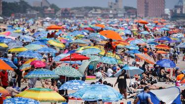 Some celebrated July Fourth virtually while others packed beaches despite coronavirus surge