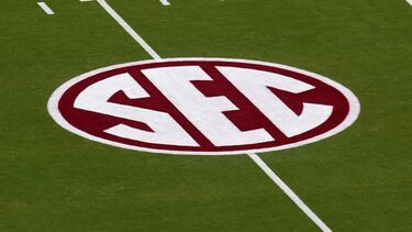 Sources -- SEC football coaches irked by added opponents